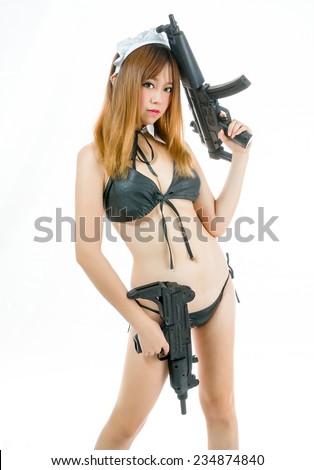 sexy asian girl model cosplay bikini maid with gun japanese style - stock photo