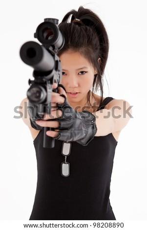 sexy Asian girl with gun - stock photo