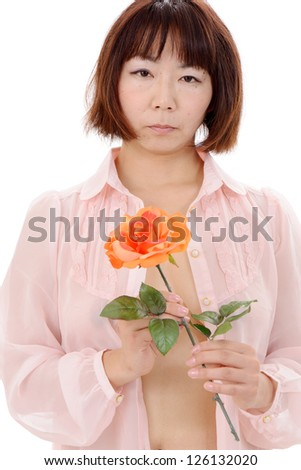 Sexy asian woman holding holding rose flower - stock photo