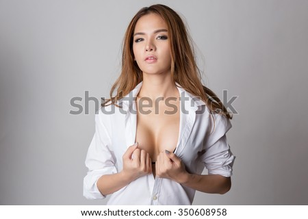 Sexy asian woman showing her sexy breast in black bra or lingerie with shirt opened. - stock photo