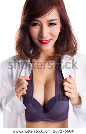 Sexy asian woman showing her sexy breast in purple bra or underwear with shirt opened by hand, isolated on white background - stock photo