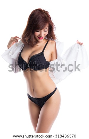 Sexy asian woman with nice body,  wearing black lingerie and white shirt. - stock photo