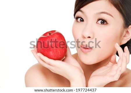 sexy asian young woman holding red apple in her hands