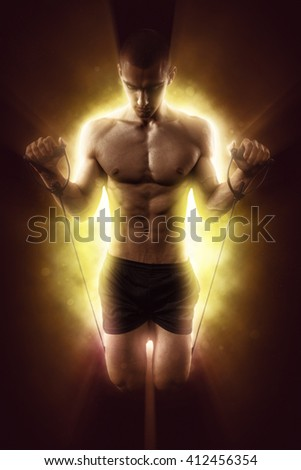 Sexy Athletic Man posing on glowing background - stock photo