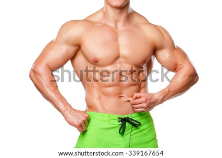 Sexy athletic man showing abdominal muscles without fat, isolated over white background. Muscular male fitness model abs