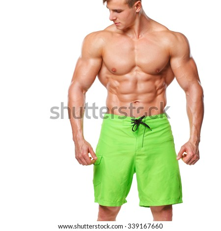 Sexy athletic man showing muscular body and sixpack abs, isolated over white background. Strong male nacked torso - stock photo