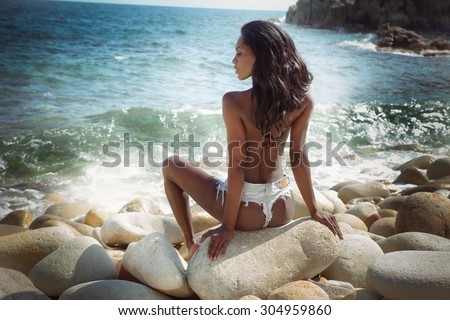 Sexy attractive african american woman relaxing on the beach. Summer style. - stock photo