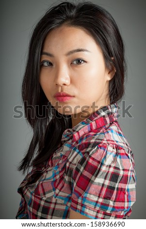 Sexy attractive asian girl country cowgirl outfit posing in studio