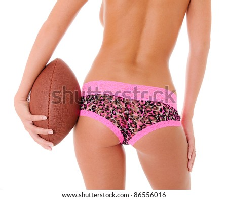 Sexy Backside of a woman holding a football wearing pink camo shorts