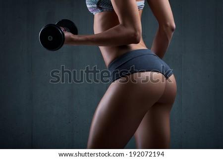 Sexy beautiful ass in thong. Beautiful athletic woman - stock photo