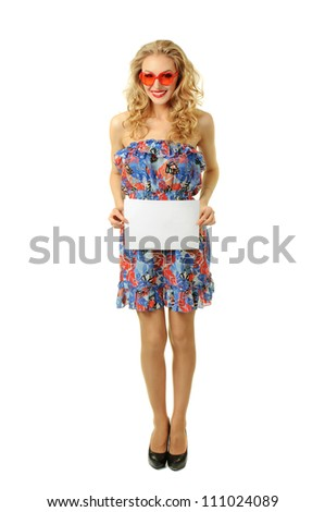 Sexy beautiful blonde girl holding blank sheet of paper