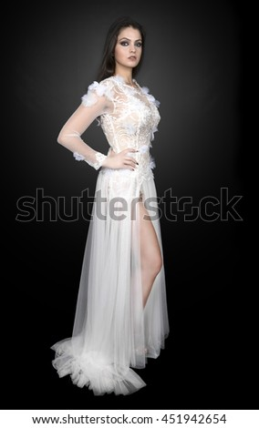sexy beautiful bride brunette girl in white wedding dress with hairstyle and bright makeup  - stock photo
