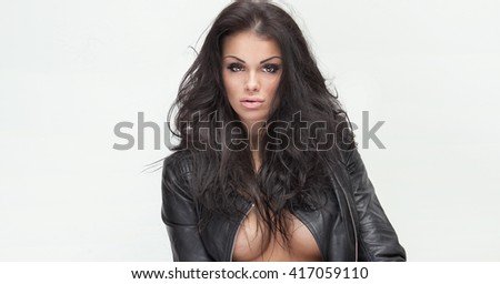 Sexy beautiful brunette woman posing in studio. Perfect body. Girl looking at camera. - stock photo
