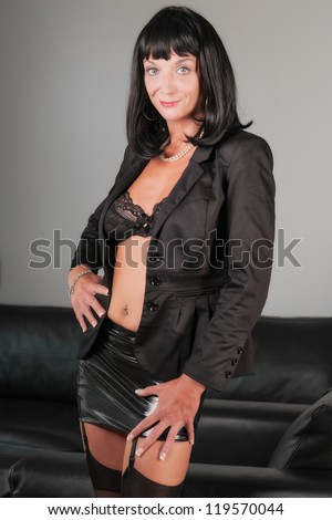 sexy beautiful business woman standing in the office - stock photo