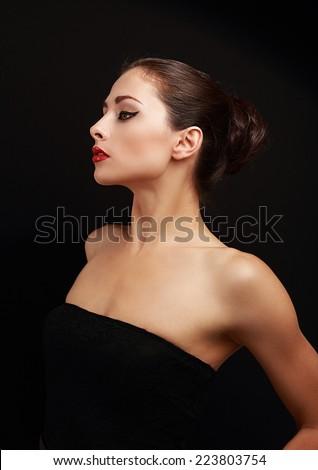 Sexy beautiful makeup woman profile on black background - stock photo