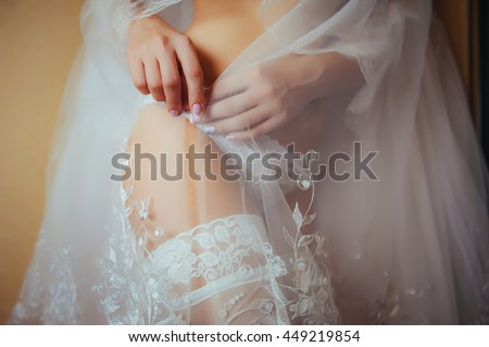 Sexy beautiful nude bride with veil in white erotic lingerie