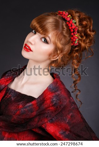 sexy beautiful redhead girl with long curly hair and a red dress.hair ornament.red lips. long thick bangs