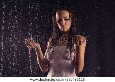 Sexy beautiful woman posing in white shirt under water - stock photo