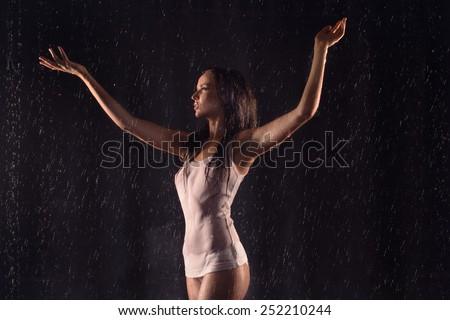 Sexy beautiful woman posing in white shirt under water - stock photo