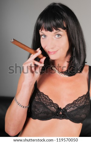 sexy beautiful woman smoking cigar - stock photo