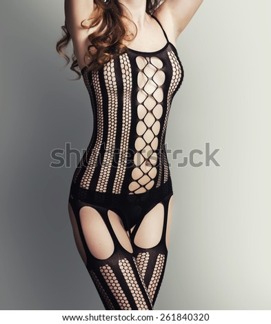 Sexy beautiful woman wearing sexual lingerie -  black fishnet body stocking suit - stock photo