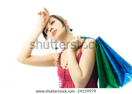 sexy beautiful young brunette woman with paper bags tired of shopping