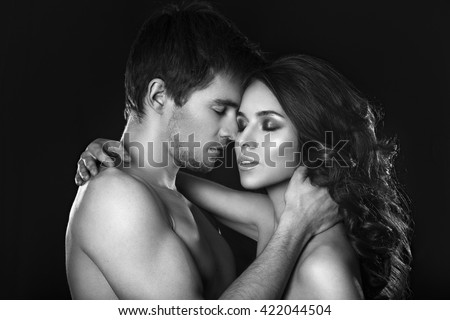Sexy beauty couple.Kissing couple portrait.Sensual brunette woman in underwear with young lover, passionate couple foreplay closeup.Sexy couple in intimacy relations - stock photo