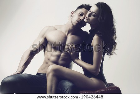 Sexy beauty couple posing in studio.Glamour colors. - stock photo