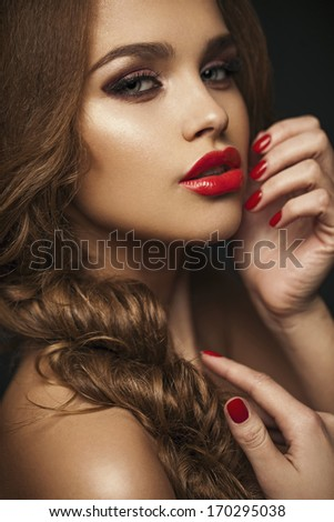Sexy Beauty Girl with Red Lips and Nails. Provocative Make up. Luxury Woman with Blue Eyes. Gorgeous Woman Face. Long Hair - stock photo