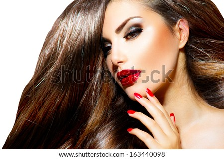 Sexy Beauty Girl with Red Lips and Nails. Provocative Make up. Luxury Woman with Long Brown Smooth Hair. Fashion Brunette Portrait isolated on a white background. Gorgeous Woman Face.  - stock photo