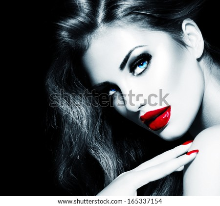 Sexy Beauty Girl with Red Lips and Nails. Provocative Make up. Luxury Woman with Long Hair. Fashion Brunette Model Black and White Portrait isolated on Black background. Gorgeous Woman Face.  - stock photo