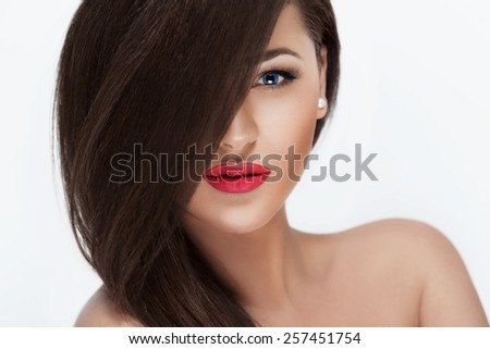 Sexy Beauty Girl with Red Lips. Provocative Make up. Luxury Woman with Blue Eyes. Fashion Brunette Portrait isolated on a white background. Gorgeous Woman Face. Long Hair  - stock photo