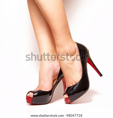 Sexy beauty long woman legs wearing fashion high heel shoes isolated on white studio background