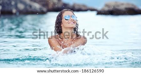 Sexy  bikini model splashing water  - stock photo