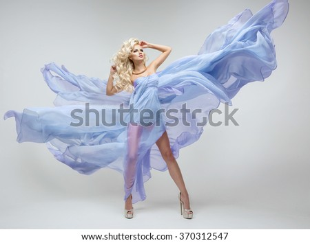 Sexy blond beauty woman in blue dress