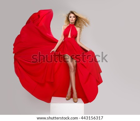 Sexy blond beauty woman in red dress