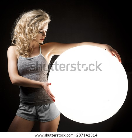 Sexy blond girl with white flash ball - stock photo