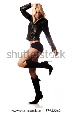 sexy blond in shorts,  high heels and leatjer jacket in motion - stock photo