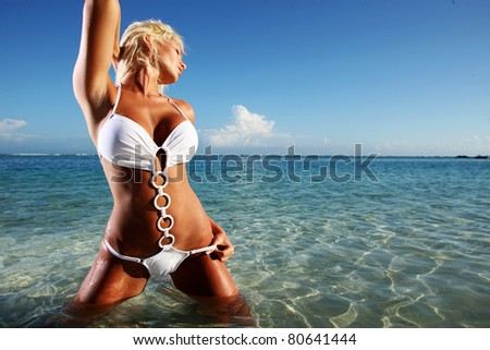 Sexy blond model in a white bikini - stock photo