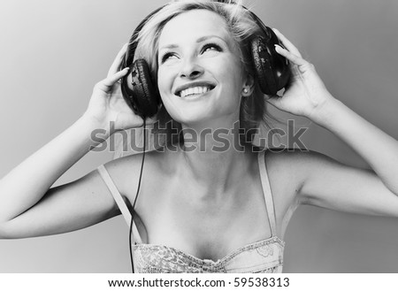 Sexy blond model Listens to music. - stock photo