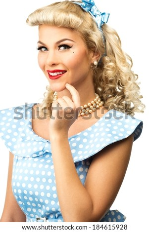 Sexy blond pin up style young woman in blue dress - stock photo