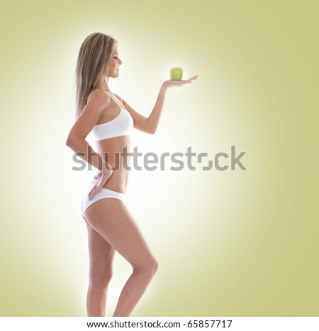 Sexy blond with apple isolated over white background - stock photo