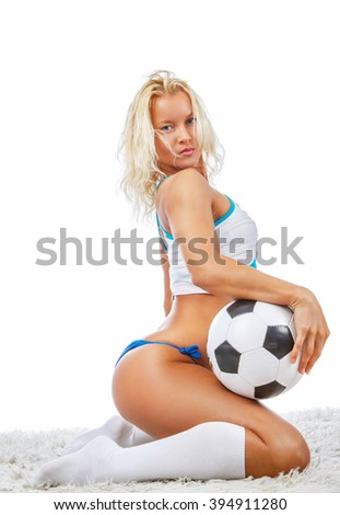 Sexy blond woman in a blue panties posing with soccer ball.