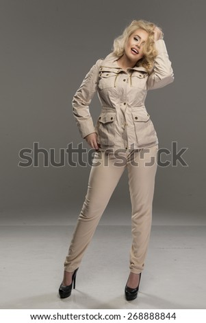 Sexy blond woman in beige clothes - stock photo