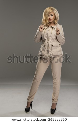 Sexy blond woman in beige clothes