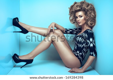 Sexy blond woman on blue background