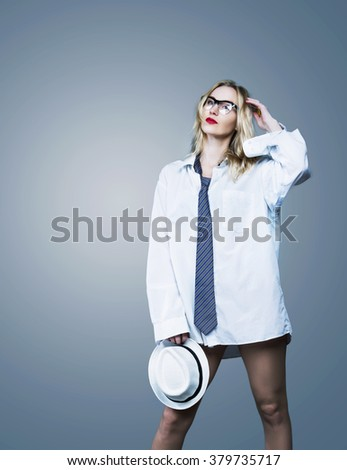 sexy blond woman wearing a shirt and glasses