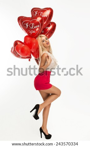 Sexy blond woman with balloons heart - stock photo