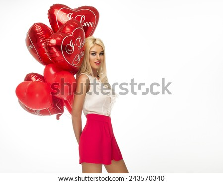 Sexy blond woman with red heart balloons - stock photo