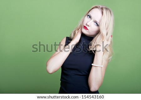 Sexy blonde businesswoman with hands in her hair - stock photo